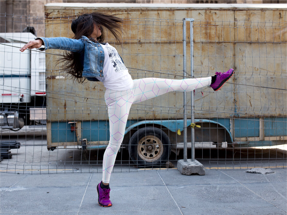 AwakeNAware.com-Awake-&-Aware-Dancing-Woman-Wearing-White-Geometric-Patterned-Yoga-Pants