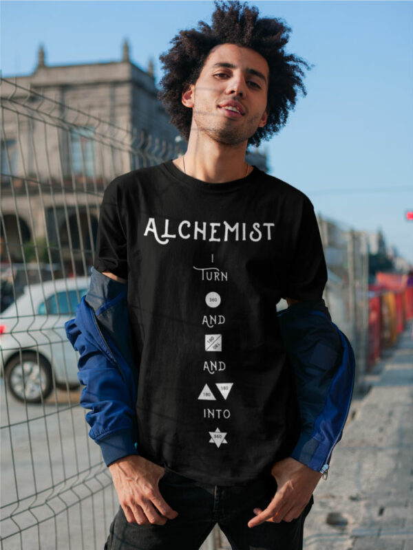 AwakenAware.com-Awake-&-Aware-mockup-of-a-man-with-a-coy-smile-wearing-an-Alchemist-t-shirt-18077